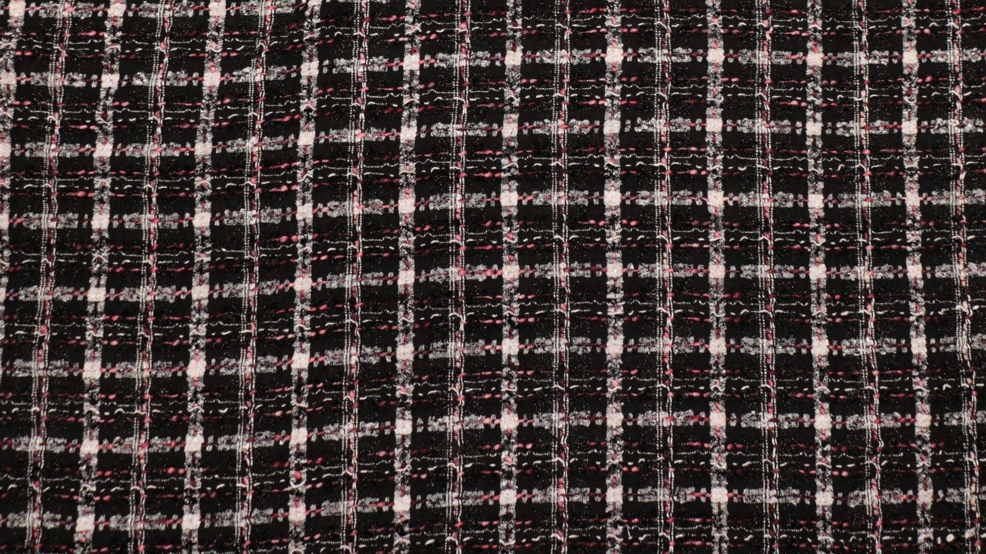 il particolare del tessuto tailleursuniverse, appartenente alla categoria fantasie tailleurs, di Leadford & Logan